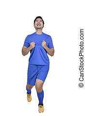 Happy asian football player man celebrate after scoring a goal