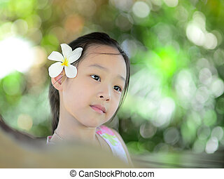 Happy Asian girl outdoor with bokeh background