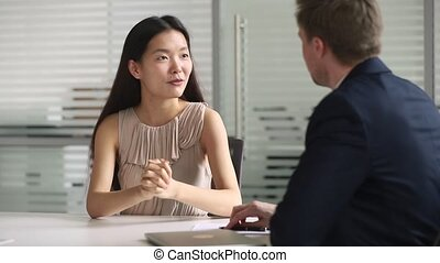 Happy asian job candidate handshake hr get hired at...