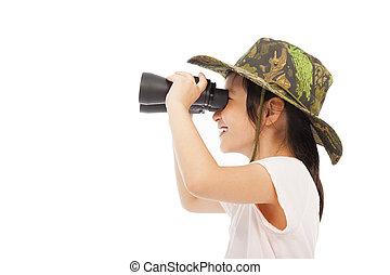 happy asian Little girl looking through binoculars.
