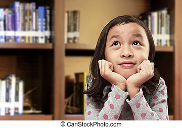 Happy asian little girl with funny expression