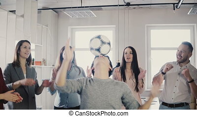 Happy Asian man tries to juggle football on head. Positive ...