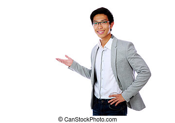 Happy asian man with arm out in a welcoming gesture