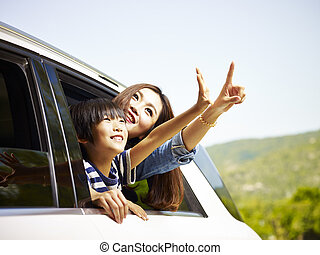 happy asian mother and daughter on a sightseeing trip