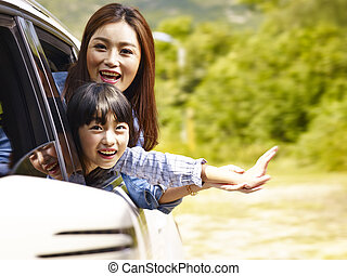 happy asian mother and son on a sightseeing trip
