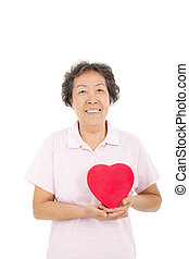 happy asian  senior woman with  red heart