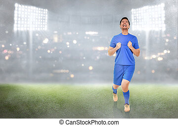 Happy asian soccer player celebrate his goals