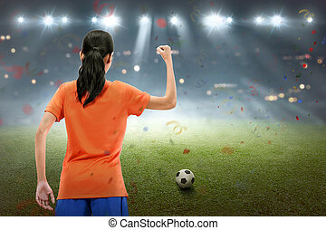 Happy asian soccer player woman celebrate the match win