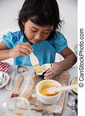 happy asian toddler make a dough