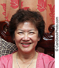 Happy Asian Woman - A happy, middle-aged asian woman.