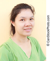 Happy Asian woman close up shot.