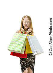 Happy asian woman in dress holding shopping bags