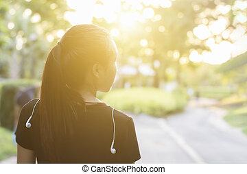 Happy Asian woman in park