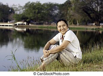 Happy Asian Woman in Public Park