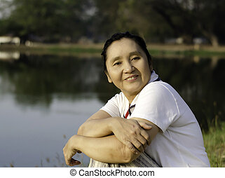 Happy asian woman in the park