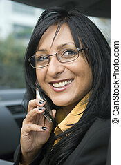 happy asian woman on cellphone