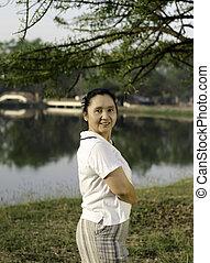 Happy asian woman posing
