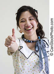 Happy asian woman show thumps up