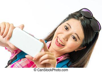 Happy asian woman tourist taking selfie