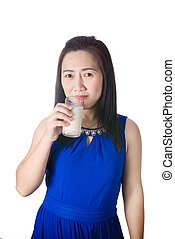 Happy Asian woman with glass of milk in hand isolated on white background