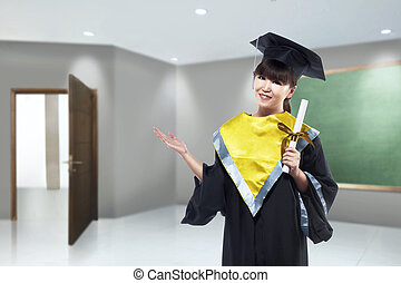 Happy asian woman with graduation cap and diploma scroll