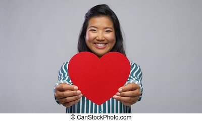 happy asian woman with red heart - love, charity and ...