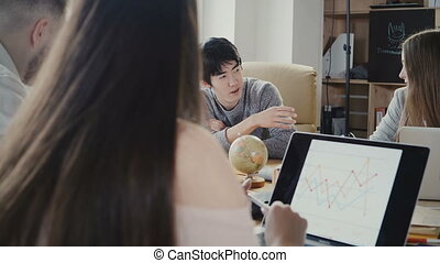 Happy Asian young businessman speaking at financial company staff meeting. Multiethnic team discuss cryptocurrencies 4K.