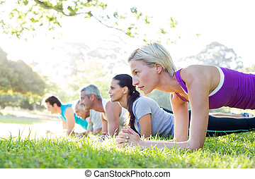 Happy athletic group training