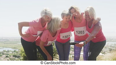 Happy athletics women taking picture - Fun run race in the ...