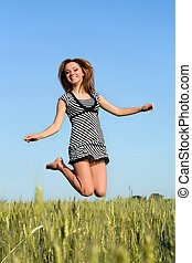 attractive girl jumping in field