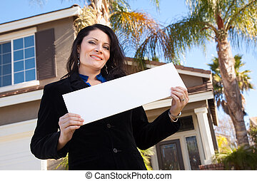 Attractive Hispanic Woman Holding Blank Sign in Front of...