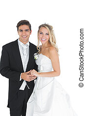 Happy attractive married couple posing holding hands