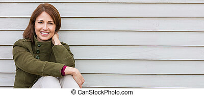 Happy Attractive Middle Aged Woman Smiling Outside