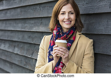 Happy Attractive Middle Aged Woman Drinking Coffee