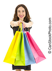 Happy attractive shopping woman showing colorful shopping bags