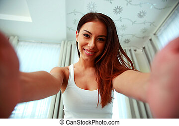Happy attractive woman smiling at camera