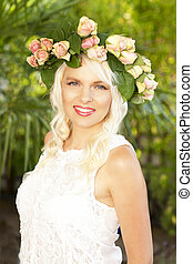 Happy attractive woman with flowers in her hair