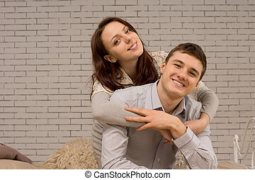 Happy attractive young couple relaxing together