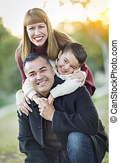 Young Mixed Race Family Portrait Outdoors