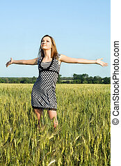 attractive young woman in the field
