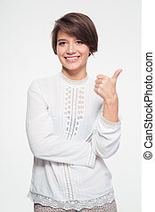 Happy attractive young woman showing thumbs up