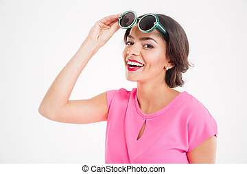 Happy attractive young woman with sunglasses smiling