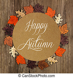 Happy Autumn greeting card with frame of wooden autumn leaves