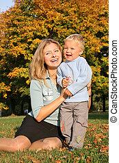 happy autumn mother child