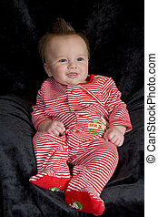 Happy Baby - A happy baby boy in a christmas outfit.