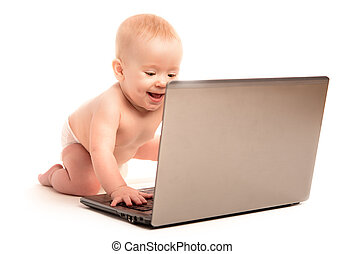 happy baby and a laptop computer isolated