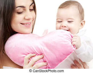 baby and mama with heart-shaped pillow