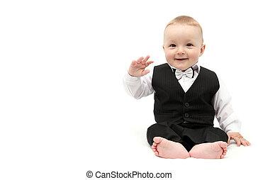 Happy baby boy in suit