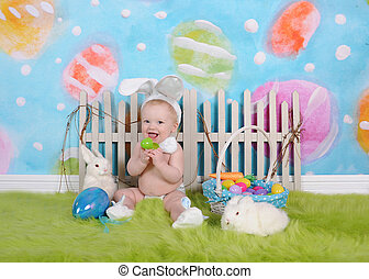 happy baby boy with easter headband in easter scene