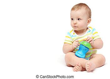 baby boy with milk bottle